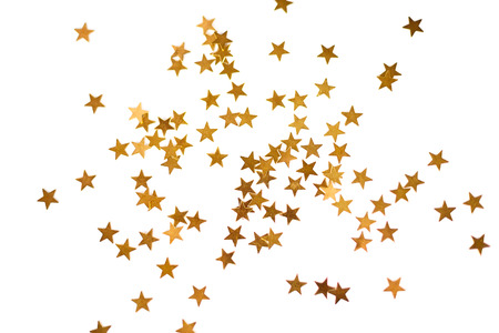 Holiday background with little golden stars isolated on white