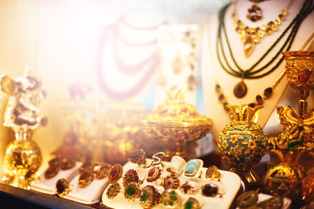 Eastern jewelry market with rings, necklaces and traditional souvenirs. Toned with warm colors. Selective focus.