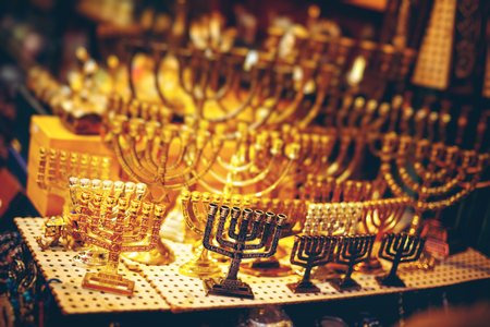 show case: Menorah Show Case at the Jerusalem Old City Bazaar. Abstract Blurred Background. Selective Focus, Shallow DOF. Stock Photo