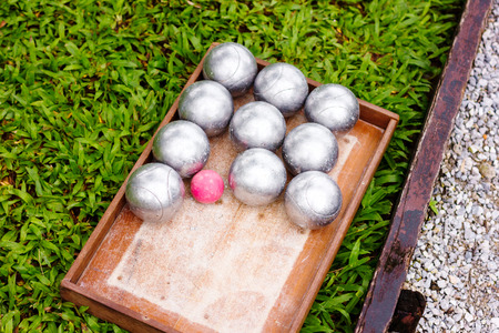 petanque: Petanque Metal Balls ready for Playing on Grass. Selective focus. Stock Photo
