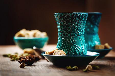surface view: Tea or Hot Wine with Various Spices in Traditional Turkish Glasses on Wooden Background. Selective Focus. Surface View. Stock Photo