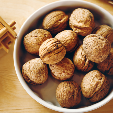 square composition: Walnuts. Close Up View From Above. Selective Focus, Square Composition.
