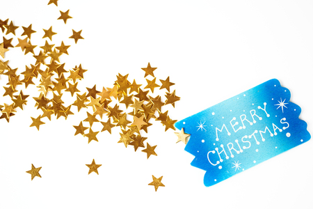 Christmas background with small blue signboard with greetings christmas background with small blue signboard with greetings and little golden stars in bulk on white m4hsunfo