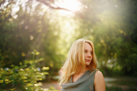attractive female: Thoughtful Woman in Summer Sunny Day. Outdoor Portrait. Space for Your Text. Selective Focus. Stock Photo