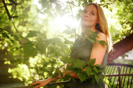 meditative: Young Romantic Meditative Woman in Summer Day. Outdoor Portrait. Selective Soft Focus, Shallow Depth of Field, Backlight. Stock Photo