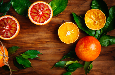 Still Life with Ripe Juicy Citrus Fruits on Wooden Table Ready for Eat. Vibrant Colors, Top View, Space for Text.