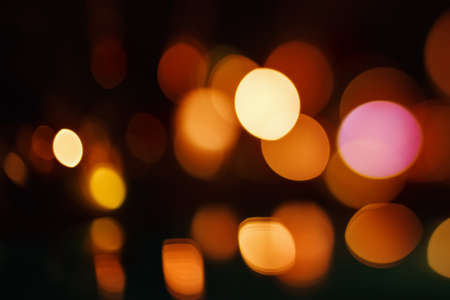 bokeh lights: Beautiful Bokeh Lights on Dark Background. Defocused Blurred City Lights. Yellow and Red Colors.