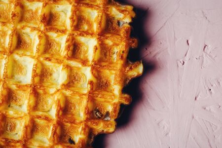 foodies: Homemade Waffles Close Up View on Pink Background. Selective Focus. Stock Photo