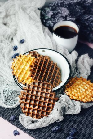 foodies: Waffles with Chocolate Icing with Coffee and Lavender Sweets Served in Old-fasioned Tableware. Selective Focus.