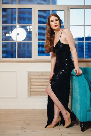 slit: Full Body Portrait of Beautiful Young Woman in Luxury Black Dress with Slit.