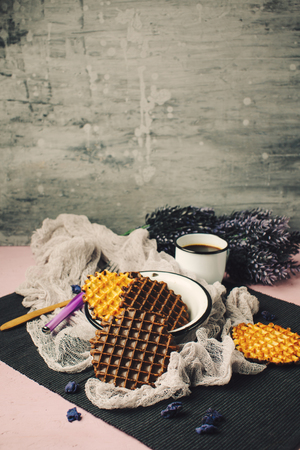 FOODIES: Waffles with Chocolate Icing with Coffee. Rustic Style. Image Toned with Retro Colors. Space for Text Over Composition.