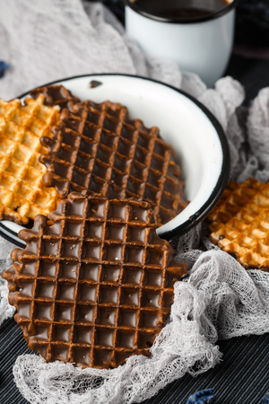 FOODIES: Round Belgian Waffles with Chocolate Icing Close-up. Rustic Style.