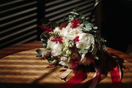 luxuriant: Luxuriant wedding bouquet of different flowers in rustic style. Space for text. Selective focus.