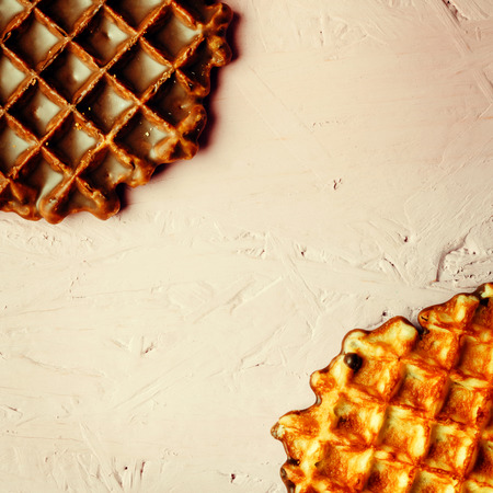 space for text: Homemade Waffles Close Up View on Pink Background. Selective Focus. Space for Text.