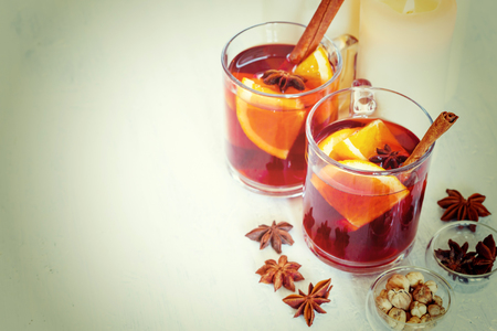 mulled wine spice: Christmas Winter Drink. Two Glasses with Mulled Wine. Selective Focus, Shallow DOF. Image Toned with Instagram Colors.