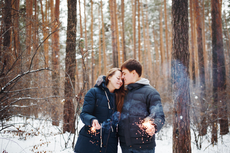 having fun in the snow: Couple in love having fun in winter holidays. Snow forest. Stock Photo