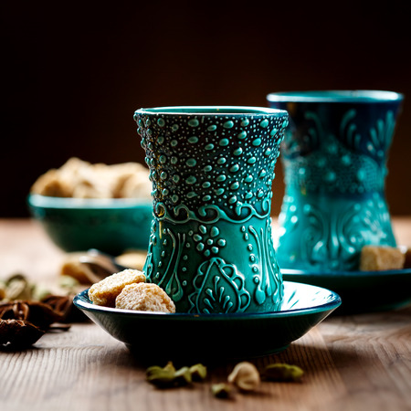 Authentic blue dishware, masala tea or hot drink with spices, selective focus