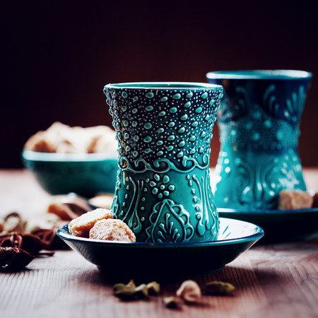 tea hot drink: Authentic blue armudu dishware, masala tea or hot drink with spices, selective focus