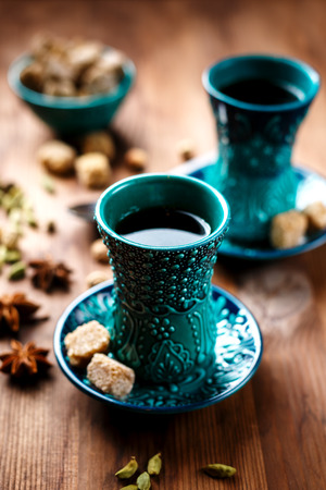 masala chai: Hot drink with spices in authentic eastern arabic dish, masala chai or spiced tea or hot mulled wine