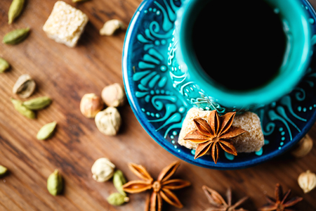 masala chai: Hot drink with spices in authentic eastern arabic dish, masala chai or spiced tea or hot mulled wine, top view, selective focus Stock Photo