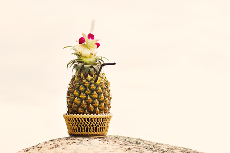 colada: Exotic cocktail, pina colada in a pineapple in sunny day Stock Photo