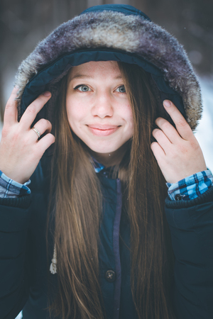 warm clothes: Headshot of young beautiful woman with long hair in warm clothes Stock Photo