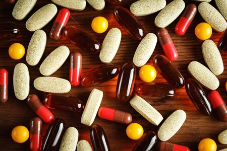 lecithin: Organic dietary treatment, vitamin capsules on wooden background, top view, close-up