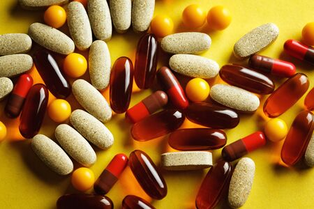 lecithin: Different sorts of organic dietary treatment, vitamin capsules, top view Stock Photo