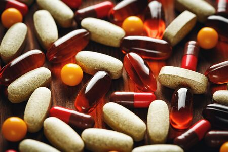 lecithin: Organic dietary treatment, vitamin capsules on wooden background, selective focus, close-up