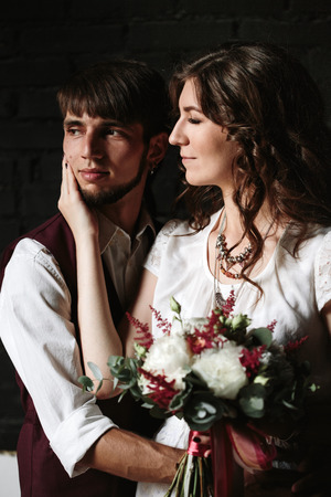 dark interior: Wedding couple posing in the dark interior