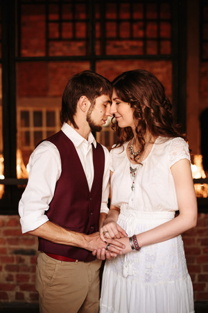loft interior: Loving couple holding hands. Loving wedding couple in loft interior. Stock Photo