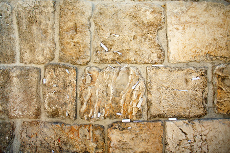 Close-up of notes to God in the Western Wall in Jerusalem, Israel Stock Photo
