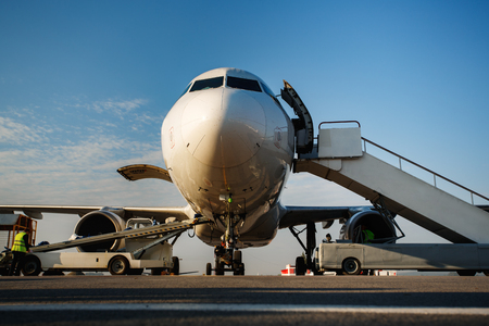 Preflight service, aircraft maintenance, baggage is loading into the luggage compartment of the aircraft at the airport Stock Photo
