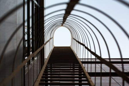 escape: Metal construction with stairs, fire escape Stock Photo