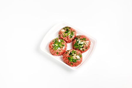 semifinished: Raw food, beef cutlet ready for prepare. Minced meat in plastic box on white background. Stock Photo