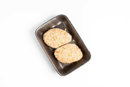 Raw food, chicken cutlet ready for prepare. Minced chicken portion in plastic box on white background.
