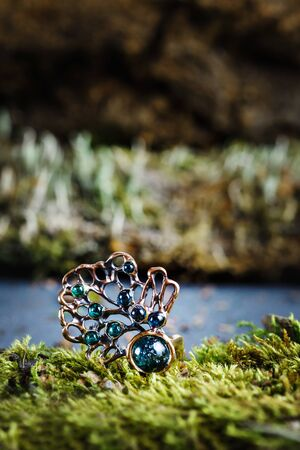 Beautiful ring with nature ornament on natural background, close-up view Reklamní fotografie