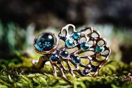 Beautiful ring with nature ornament on natural background, close-up view Imagens