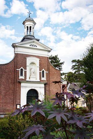 Catholic church in garden of the Begijnhof or Beguinage in Breda, Netherlands