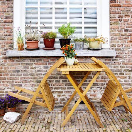 Cozy place for rest on backyard, window with flowers 版權商用圖片