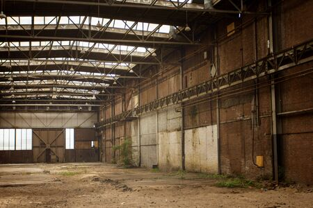 Abandoned empty old factory workshop interior with roof light