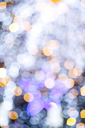 Abstract night holiday background with defocused Christmas illumination and bokeh star shape Standard-Bild