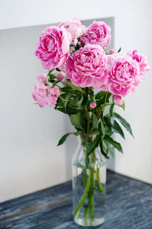 Flower bouquet of pink natural peonies flowers in a vase, spring and summer season flowers