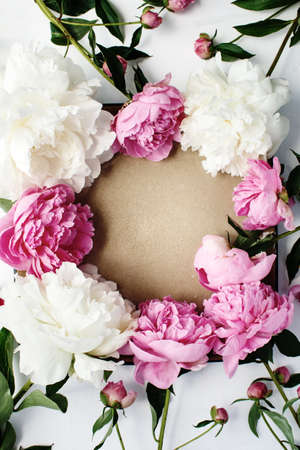 Simple flat lay flower frame of pink and white peonies, spring and summer season concept