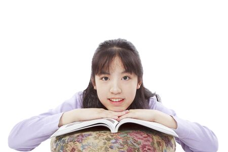 emulate: A smile and cute Asian girl seriously learning Stock Photo