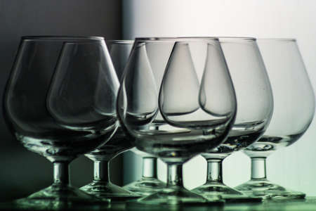 depends: Glass illusion. simple empty glasses arranged on different rows, creating a nice optical illusion. It all depends on perspective.