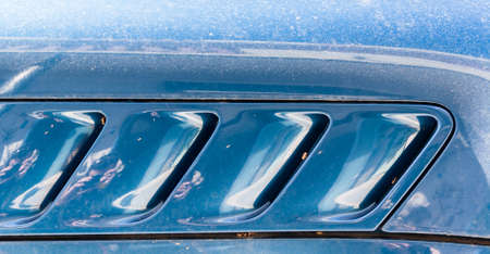 intake: Blue speed. The detail of a sports car. The air intake conveys the sense of speed. Stock Photo