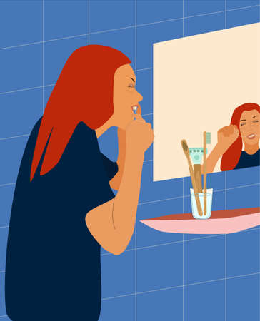 Young woman brushes her teeth with dental floss in the bathroom in front of the mirror.Dental and orthodontic daily life vector concept for clinic.Oral care.Healthy smile.Getting ready for the bed 免版税图像 - 152658193