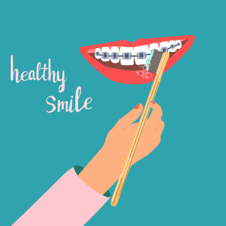Smile with dental braces.Orthodontic health daily life concept.Human hand cleaning teeth with bamboo toothbrush. Oral care. Correction of bite and a beautiful smile. Vector concept for medical clinic