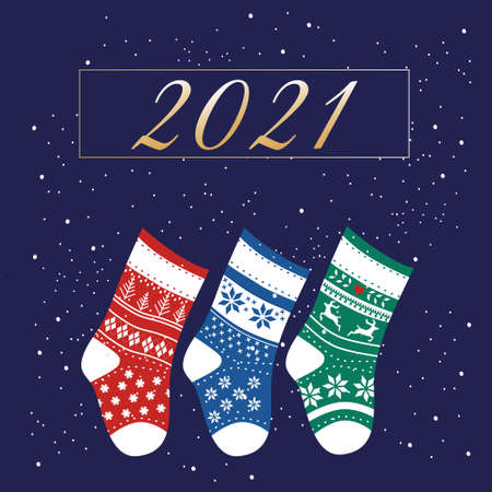 Winter collection of knitted socks different colours and ornaments.Warm woolen Scandinavian knee-highs for presents.Happy New Year 2021 and Christmas card.Snowflakes around.Children's accessory,sale